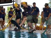 Navy divers jump into a pool for a training dive with Royal Thai Navy divers during CARAT 2011