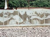 English: Close-up of a section of the floodwall along the Tug Fork River at Matewan, West Virginia, USA. The U.S. Army Corps of Engineers constructed levees and floodwalls along the river to protect the town. The wall depicts the families involved in the