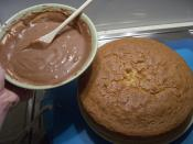 Cookbook:Chocolate Sour-Cream Icing about to be spread on Cookbook:1-2-3-4 Cake.