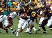 Nate Longshore (#6) prepares to throw a pass during a home game against the Arizona State Sun Devils.