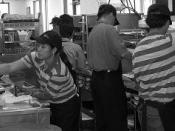 English: After a big order of 13 Big Macs comes in, the crew snaps into working mode in a hurry to get the burgers expertly prepared in a timely and efficent manner.