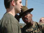Sergeant Paul Nixon, drill instructor, 3rd Recruit Training Battalion, , , gives a poolee some added incentive to do what he's told. Approximately 400 future Marines gathered May 7, 2005 at Fort Indian Town Gap, Pennsylvania, for Recruiting Station Harris