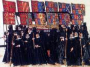 Banner bearers at the funeral of Elizabeth I of England. The casket of the queen is accompanied by mourners bearing the heraldic banners of her ancestors' coats of arms marshalled (side-by-side) with the arms of their wives.