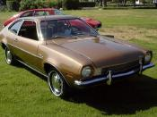 Ford Pinto. Foreground car is a restored example; background is a hot-rodded version with popup headlights.