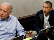 English: A burn bag, and security classification stickers on a laptop computer, between U.S. President Barack Obama and Vice President Joe Biden during updates on Operation Geronimo, a mission against Osama bin Laden, in the Situation Room of the White Ho