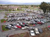 A parking lot with landscaping and a diagonal parking pattern designed for one-way traffic.