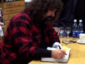 Mick Foley signing autographs