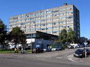 The James Watt College Waterfront Campus, Greenock in Scotland, with a view of the Firth of Clyde and residences to the right.