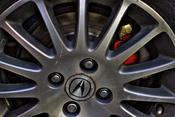 English: Image of the lug-nuts on an Acura.