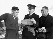 R.C.N. officer questioning Japanese-Canadian fishermen while confiscating their boat.