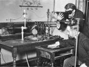 Taking an X-ray image with early Crookes tube apparatus, late 1800s.
