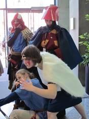 Cosplayers portraying Ashitaka, Lady Eboshi, and San from Princess Mononoke at FanimeCon 2010 in San Jose, California.