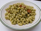 English: A plate of cellentani (also referred to as cavatappi) pasta with pesto and tomatoes as prepared by the photographer.