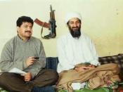 English: Hamid Mir interviewing Osama bin Laden for Daily Pakistan in 1997 behind them on the wall is an AKS-74U carbine.