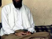 English: Osama bin Laden interviewed for Daily Pakistan in 1997; behind him on the wall is an AK-47 carbine.