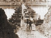 Egyptian trucks cross on one of the bridges laid across the Suez Canal during the
