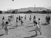Japanese American women playing volleyball, Manzanar internment camp, California, ca. 1943.
