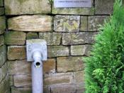 English: Site of the old village pump - Odcombe Now furnished with what looks to be a standpipe. The plaque above says: