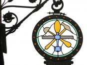 Traditional wrought-iron guild sign of a glazier - in Germany. These signs can be found in many old European towns where guild members marked their places of business. Many survived through time or staged a comeback in industrial times. Today they are new