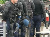 Riot control gear: body armour, shield, tear gas mask, apparatus for throwing tear gas canisters