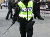 Swedish police with riot gear, notice the extended telescopic baton