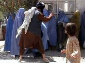 This photo is caught from a video film that has been filmed by RAWA in Kabul using a hidden camera. It shows two Taliban from department of Amro bil mahroof (Promotion of Virtue and Prevention of Vice, Taliban religious police) beating a woman in public b