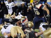 English: PHILADELPHIA (Dec. 12, 2009) Navy quarterback Ricky Dobbs (#4) scores a touchdown on a 1-yard run in the fourth quarter of the 110th Army-Navy college football game at Lincoln Financial Field in Philadelphia. Dobbs broke the NCAA Division-1 recor