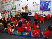 English: EWA BEACH, Hawaii (March 3, 2010) A Sailor reads to a class of kindergarten students at Iroquois Point Elementary School during a Read Across America community service visit. Read Across America is an annual event that coincides with the birthday