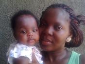 English: mrs emeka emmanuel, a nurse/midwife in abuja Nigeria, carrying baby kosarachi bernice