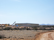 English: Fresh water storage tank under construction at Spaceport America, March 2010. The fresh water system will purify water drawn from wells on the spaceport site.