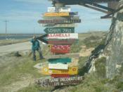 Fingerpost showing distances to various world destinations near Stanley, Falkland Islands.