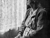 English: Portrait of old woman sitting by a window.