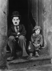 Charlie Chaplin and Jackie Coogan in The Kid