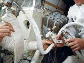 Astronaut John L. Swigert, at right, holds the