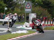 English: John McGuinness at the Magherabuoy chicane John McGuinness on his Honda leads Cameron Donald and Ian Hutchinson round the chicane during a practice for the 2009 Northwest 200. McGuinness recorded a maximum speed of 204 miles per hour during the 2