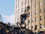 Damage to the 210 Washington Street (east) face of the Verizon Building and debris from the collapse of 7 World Trade Center