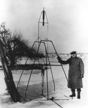 Robert H. Goddard on March 16, 1926, holding the launching frame of his most notable invention the first liquid-fueled rocket.