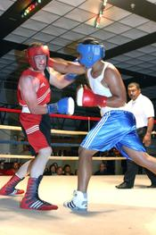 Headgear and boxing gloves are mandatory in Olympic boxing and amateur boxing.