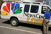 English: A news reporter and broadcasting truck for the television station KTTC in Rochester, Minnesota.