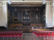 English: The Brangwyn Hall The Brangwyn Hall is a concert venue within Swansea's Guildhall. This is a shot of the stage with its built-in pipe organ. The hall is named after the panels, painted by Frank Brangwyn, that adorn its walls. See also 1491172