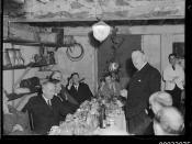 Count Felix Graf von Luckner smoking a pipe at a table with unidentified individuals