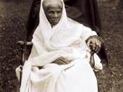 Harriet Tubman, full-length portrait, seated in chair, facing front, probably at her home in Auburn, New York