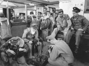 Enlisted men of Base Photo drawing cameras to go up in a Beechraft AT-11 on bomb-spotting missions at Roswell Army Flying School, Roswell, N.M.