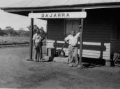 English: Wally and Fred at the Dajarra Railway Station Piece picker Wally Dunoan and presser, Fred Ennis standing at the Dajarra Railway Station.