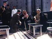English: Meets with King Ibn Saud, of Saudi Arabia, on board USS Quincy (CA-71) in the Great Bitter Lake, Egypt, on 14 February 1945. The King is speaking to the interpreter, Colonel William A. Eddy, USMC. Fleet Admiral William D. Leahy, USN, the Presiden