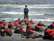 First Phase A Navy SEAL Instructor in Class 245 provides a lesson to his trainees on listening to instruction.