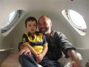 A father and his son inside a hyperbaric oxygen chamber. The boy is being treated for autism spectrum disorders.