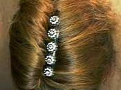 English: This is a photo of a French twist using one of byrd designs original hair accessories.