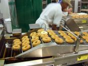 Selfridges has a Krispy Kreme Doughnut shop which has its own doughnut production line thing. Tasty.