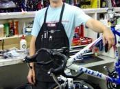 English: Bike mechanic at a local bike shop